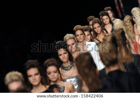 MILAN, ITALY - SEPTEMBER 29: Models walk during the Fashion week in Milan September, 29 2009. Fashion show of the collection  JOHN RICHMOND - stock photo