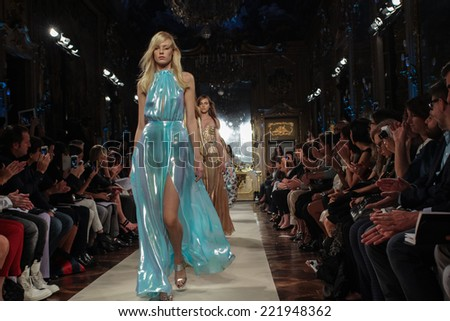 MILAN, ITALY - SEPTEMBER 20: Models walk the runway finale during the Genny show as part of Milan Fashion Week Womenswear Spring-Summer 2015 on September 20, 2014 in Milan, Italy. - stock photo