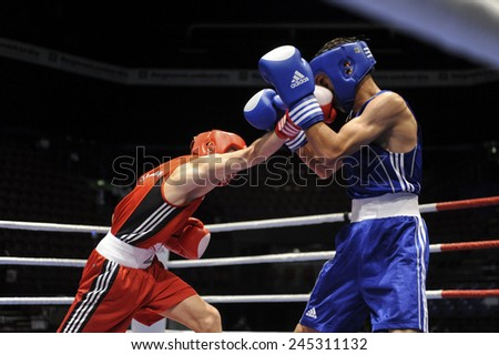 MILAN, ITALY-SEPTEMBER 05, 2009: non professional boxe match ablizimov vs alwadi of the boxe amateur world championship, in Milan