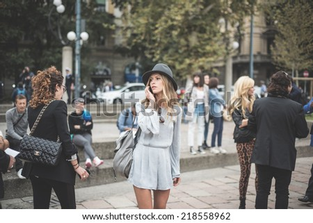 MILAN, ITALY - SEPTEMBER 20: People during Milan Fashion week in Milan, Italy on September, 20 2014. Eccentric and fashionable people in the city during fashion week wait for models and famous people - stock photo