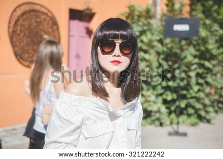 MILAN, ITALY - SEPTEMBER 24: People during Milan Fashion week, Italy on SEPTEMBER 24, 2015. Eccentric and fashionable people waiting for models and vips outside city during Milan fashion week - stock photo