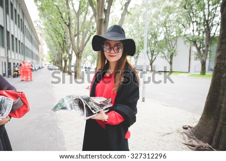MILAN, ITALY - SEPTEMBER 28: People during Milan Fashion week, Italy on SEPTEMBER 28, 2015. Eccentric and fashionable woman waiting models and vips outside city at Milan fashion week