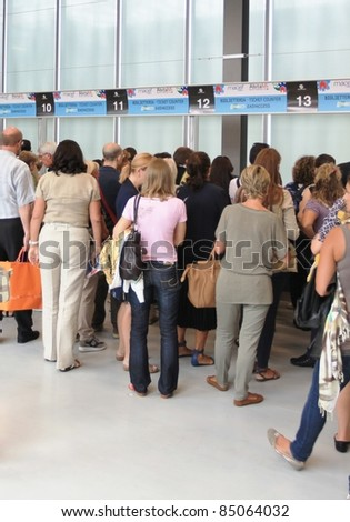 MILAN, ITALY - SEPTEMBER 09: People enter architecture and interiors design stands at  Macef, International Home Show Exhibition on September 09, 2011 in Milan, Italy.