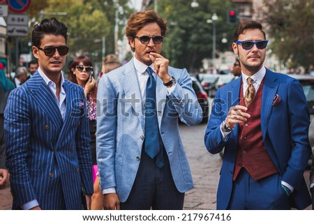 MILAN, ITALY - SEPTEMBER 17: People outside Gucci fashion shows building for Milan Women's Fashion Week on SEPTEMBER 17, 2014 in Milan. - stock photo