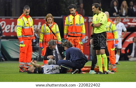 MILAN, ITALY-SEPTEMBER 24,2014: soccer player Mauro Icardi  receives medical first aid after an injury, during the serie A match FC Internazionale vs Atalanta at the San Siro stadium, in Milan. - stock photo
