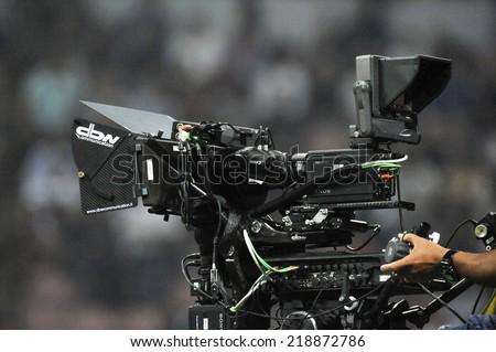 MILAN, ITALY-SEPTEMBER 20, 2014: television camera at the San Siro stadium, during the professional serie A soccer match AC Milan vs Juventus, in Milan. - stock photo