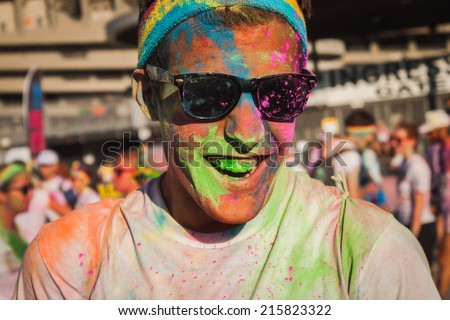 MILAN, ITALY - SEPTEMBER 6: Thousands of people take part in the Color Run event, the funniest and most colorful urban running ever on SEPTEMBER 6, 2014 in Milan. - stock photo