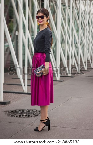 MILAN, ITALY - SEPTEMBER 20: Woman poses outside Jil Sander fashion shows building for Milan Women's Fashion Week on SEPTEMBER 20, 2014 in Milan.