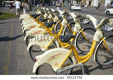 MILAN, LOMBARDY, ITALY - MAY 25: Bike sharing offers citizens and tourists low-cost access to bicycles to ease traffic congestion and curb pollution.  May 25, 2011 in Milan, Lombardy, Italy