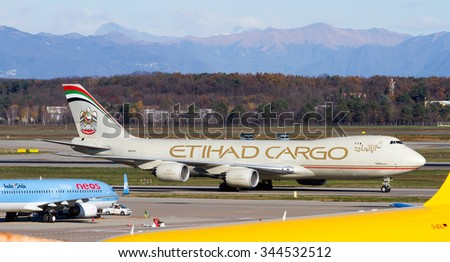 MILAN MALPENSA - NOVEMBER 27, 2015: Boeing 747-8 Etihad Cargo on the taxyway of Malpensa Cargo City Area - stock photo
