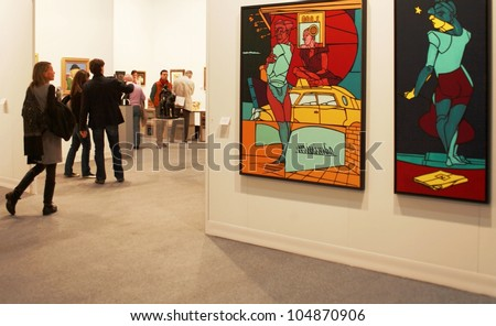 MILAN - MARCH 27: A woman enters paintings galleries during MiArt ArtNow, international exhibition of modern and contemporary art March 27, 2010 in Milan, Italy. - stock photo
