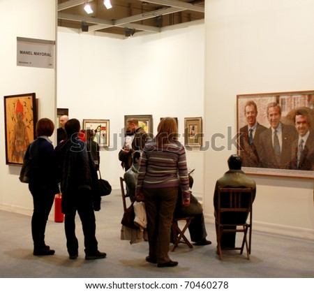 MILAN - MARCH 27: People look at arts galleries during MiArt ArtNow, international exhibition of modern and contemporary art March 27, 2010 in Milan, Italy. - stock photo