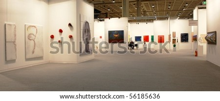 MILAN - MARCH 27: People look at works of art during MiArt ArtNow, international exhibition of modern and contemporary art March 27, 2010 in Milan, Italy. - stock photo