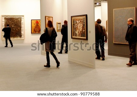 MILAN - MARCH 27: People visit paintings galleries at MiArt ArtNow, international exhibition of modern and contemporary art March 27, 2010 in Milan, Italy. - stock photo