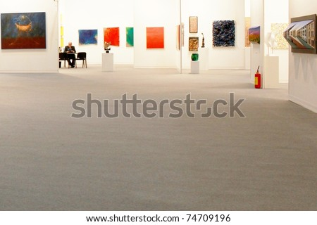 MILAN - MARCH 27: People visit sculpture, painting and art galleries during MiArt ArtNow, international exhibition of modern and contemporary art March 27, 2010 in Milan, Italy. - stock photo