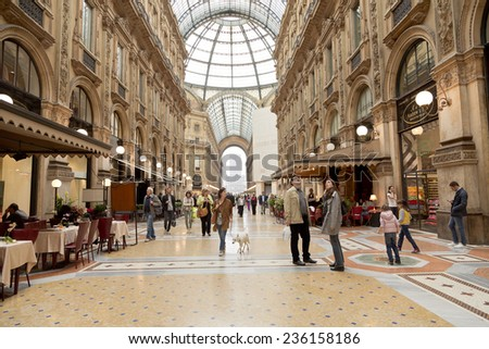 MILAN - MAY 7: Vittorio Emmanuele II shopping gallery on May 7, 2014 in Milan, Italy. Inaugurated in 1865, the gallery claims to be the oldest shopping center worldwide. - stock photo