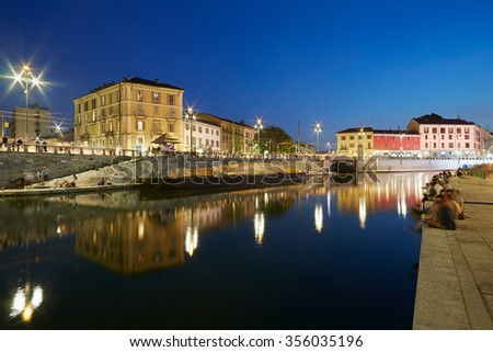 Milan new Darsena, redeveloped docks area in the night, people walking and chatting in Milan, Italy. The Darsena, the canal port closed since 1979 was reopened in April 2015. - stock photo