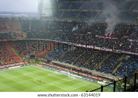 MILAN-OCTOBER 16: Supporters of Curva Sud at Italian Championship soccer game, AC Milan - Chievo on October 16, 2010 in Milan - stock photo