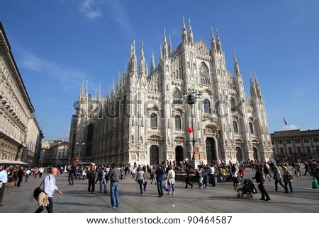 MILAN - OCTOBER 6: Tourists stroll at Piazza Duomo on October 6, 2010 in Milan, Italy. As of 2006, Milan was the 42nd most visited city worldwide, with 1.9 million annual international visitors. - stock photo