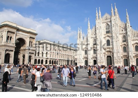 MILAN - OCTOBER 6: Tourists visit Piazza Duomo on October 6, 2010 in Milan, Italy. As of 2006, Milan was the 42nd most visited city worldwide, with 1.9 million annual international visitors. - stock photo
