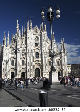 MILAN-SEPT. 24: Many tourists are seen flocking to and  from the famous ornate Duomo Cathedral Church in Milan, Italy on Sept. 24, 2015. - stock photo