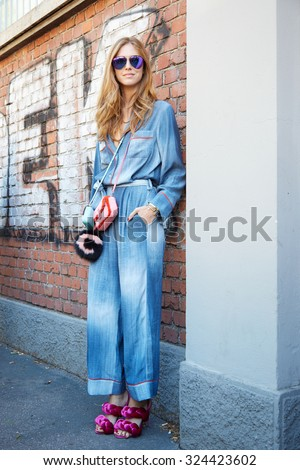 MILAN - SEPTEMBER 24: Chiara Ferragni poses for photographers in Fendi dress before Fendi show during Milan Fashion Week Day 2, Spring / Summer 2016 street style on September 24, 2015 in Milan. - stock photo