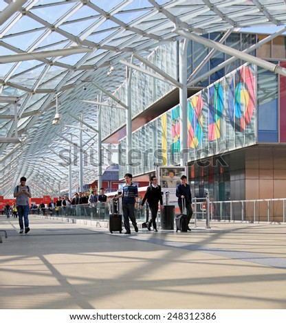 MILANO, ITALY - APRIL 10, 2014: People at the entrance of Salone del Mobile, international home furnishing and accessories design exhibition in Milano, Italy. - stock photo