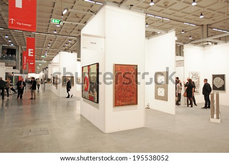 MILANO, ITALY - APRIL 08, 2011: People look at paintings galleries during MiArt, international exhibition of modern and contemporary art in Milano, Italy - stock photo
