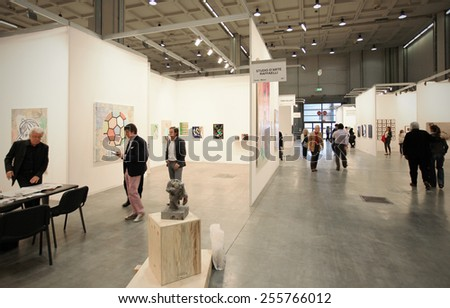 MILANO, ITALY - APRIL 08, 2011: People visit paintings galleries during MiArt, international exhibition of modern and contemporary art in Milano, Italy. - stock photo
