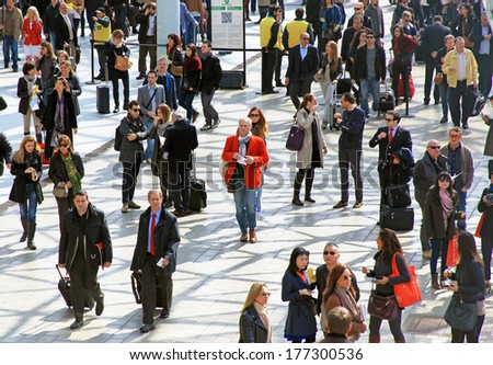 MILANO, ITALY - APRIL 10, 2013: People walk to the entrance Salone del Mobile, international furnishing accessories exhibition at Rho Fiera Center in Milano, Italy. - stock photo