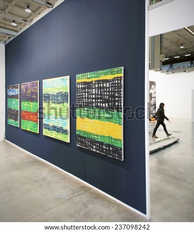 MILANO, ITALY - APRIL 07, 2013: Walking trough art paintings galleries at MiArt, international exhibition of modern and contemporary art in Milano, Italy. - stock photo