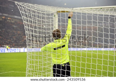 MILANO, ITALY-DECEMBER 14, 2014: referee assistant checks the the goal net at san siro stadium before the start of the italian serie A soccer match AC Milan vs Napoli, in Milan. - stock photo