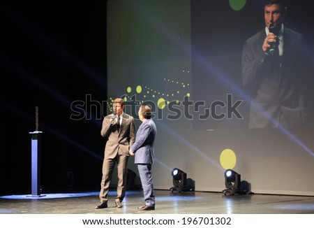 MILANO, ITALY - MAY 26, 2014: Former Football champion Javier Zanetti awarded by Piero Chiambretti at International Grand Prix Advertising Strategies opening ceremony in Milano Italy. - stock photo