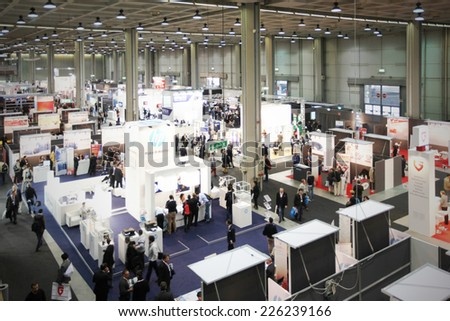 MILANO, ITALY - OCTOBER 17, 2012: Panoramic view of technology products exhibition area at SMAU, international fair of business intelligence and information technology in Milano, Italy. - stock photo