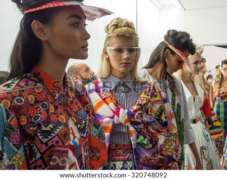MILANO, SEPTEMBER 23, 2015: models lined up at the backstage before going out on the catwalk during the Stella Jeans show for the presentation of spring-summer 15/16 collection at Milan Fashion Week. - stock photo