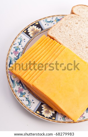 Mild Cheddar Cheese Slices - stock photo