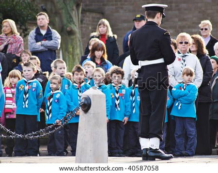 MILDENHALL, UK - NOVEMBER 8: Royal Navy Sea Cadet standing guard at the war memorial during the remembrance sunday parade and ceremony on November 8, 2009 in Mildenhall, UK. - stock photo