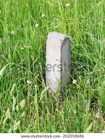 milestone in the grass - stock photo