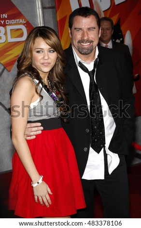 "Miley Cyrus and John Travolta at the World premiere of ""Bolt"" held at the El Capitan Theater in Hollywood, USA on November 17, 2008."