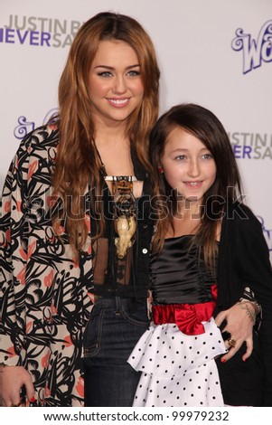 """Miley Cyrus and Noah Lindsey Cyrus  at the """"Justin Bieber: Never Say Never"""" Los Angeles Premiere, Nokia Theater, Los Angeles, CA. 02-08-11 - stock photo"""