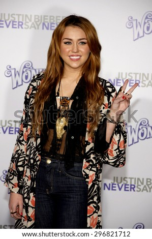 Miley Cyrus at the Los Angeles premiere of 'Justin Bieber: Never Say Never' held at the Nokia Theatre L.A. Live in Los Angeles on February 8, 2011.   - stock photo