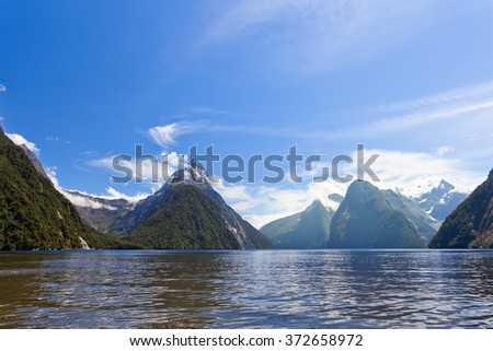 Milford Sound and Mitre Peak in Fjordland National Park, Southern Alps, New Zealand - stock photo