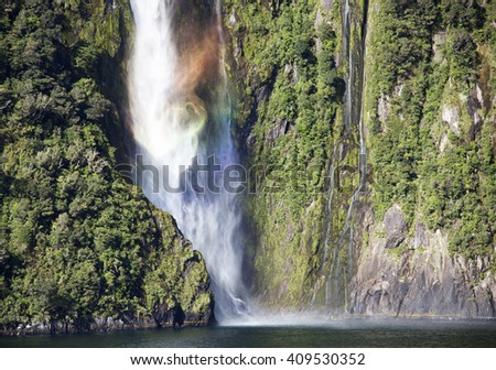 Milford Sound colored waterfall in Fiordland National Park (New Zealand).