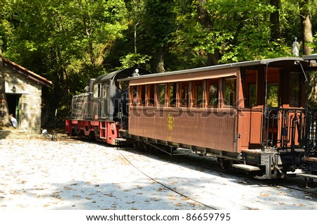 MILIES, GREECE - SEPTEMBER 25: locomotive and cars of the nostalgic Pelion Train, a weekly tourist train in the mountains of Pelion peninsula on September 25, 2011 in Milies, Greece - stock photo