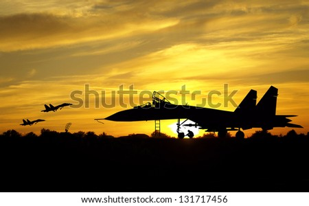 Military aircrafts silhouettes  on sunset background - stock photo