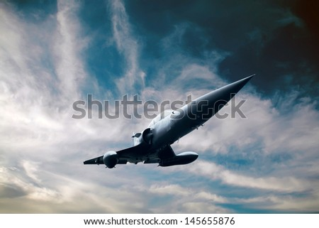 Military airplan on the speed in the sky - stock photo