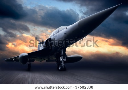Military airplane on dark sky - stock photo