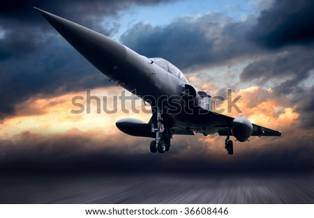 Military airplane on sunset sky - stock photo