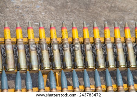 Military ammunition-heavy machine gun bullet, sign of war - stock photo