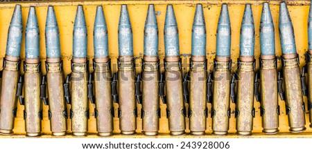 Military ammunition, heavy machine gun bullet, sign of war - stock photo